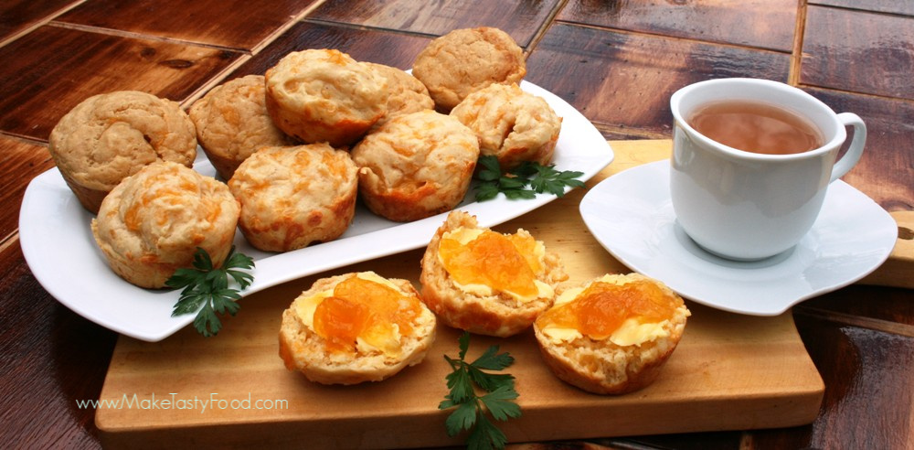 tea and cheese scones some buttered and topped with jam