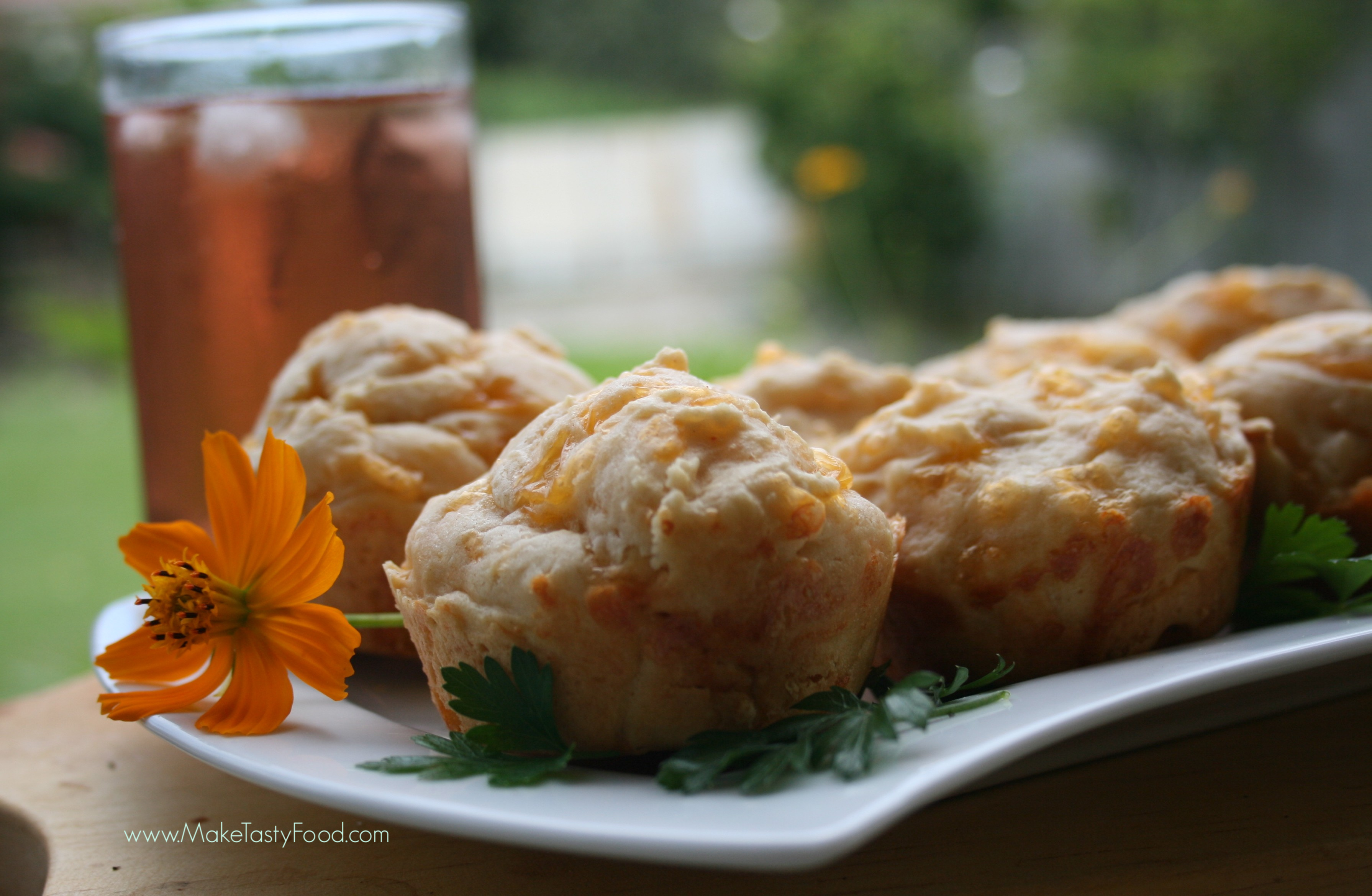 iced tea and cheese scone on a serving plate