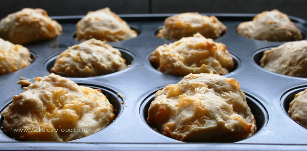 baked cheese scones in a muffin pan