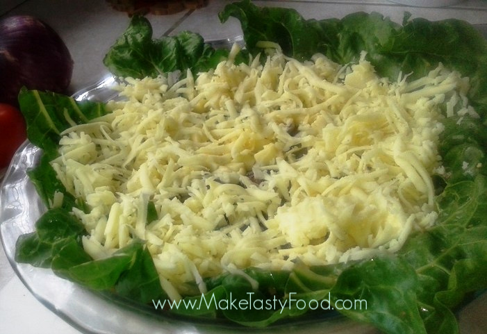 process of making this spinach base quiche and layer with some cheese