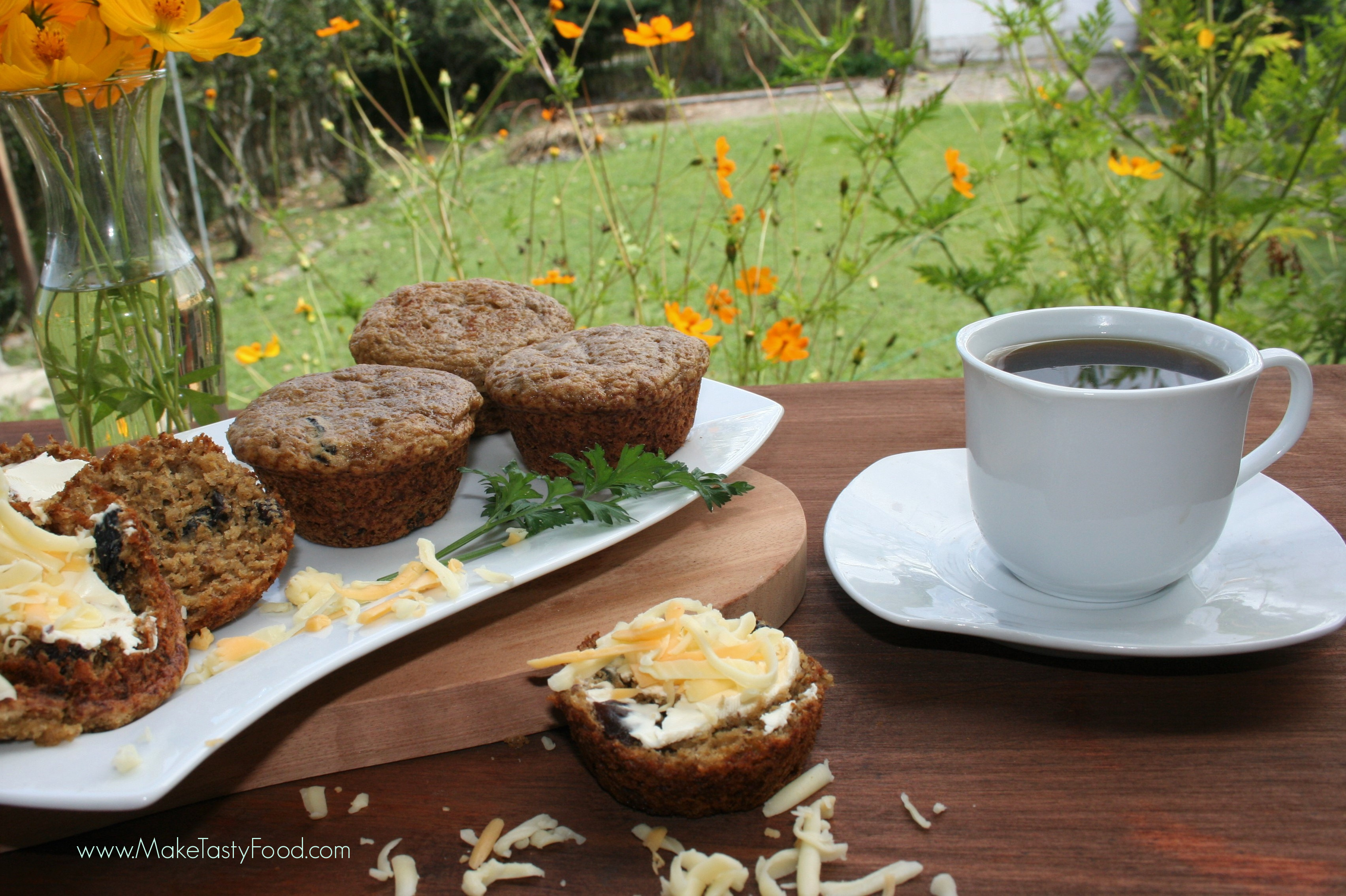 having breakfast on the stoop with coffee and banana muffins with cheese and butter spread on top