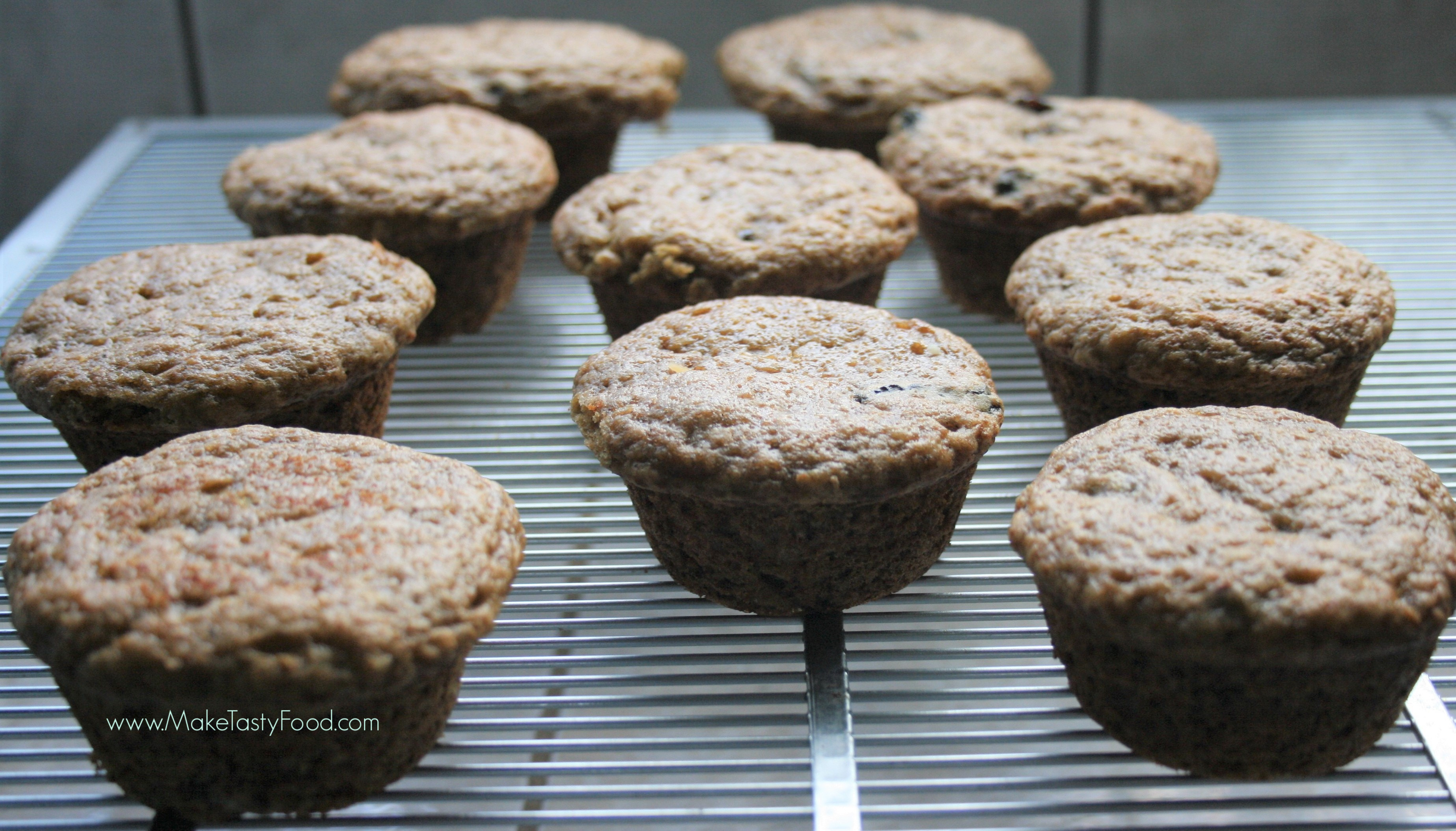 banana muffins cooling on a cooler rack