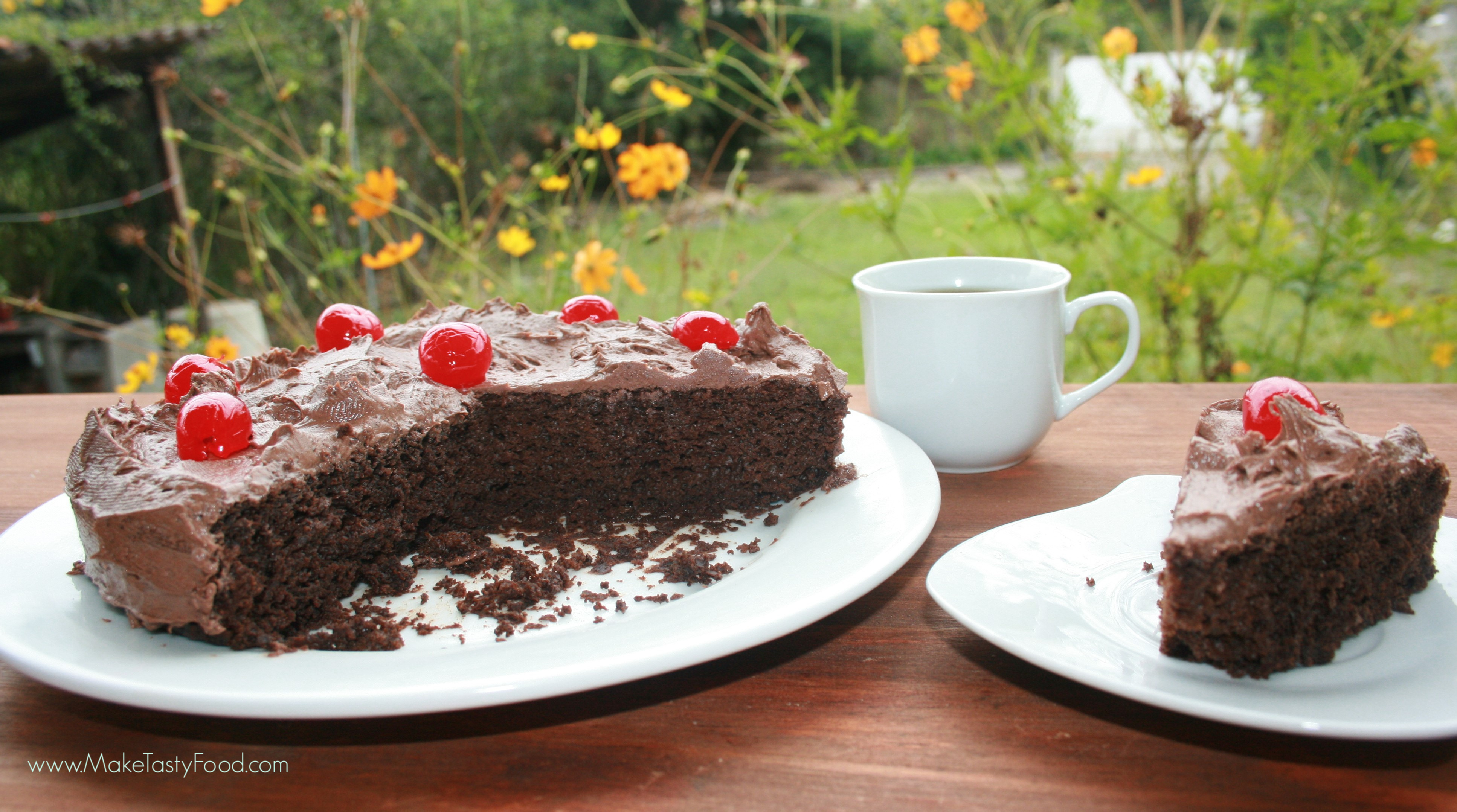 chocolate cake iced with cherries for tea