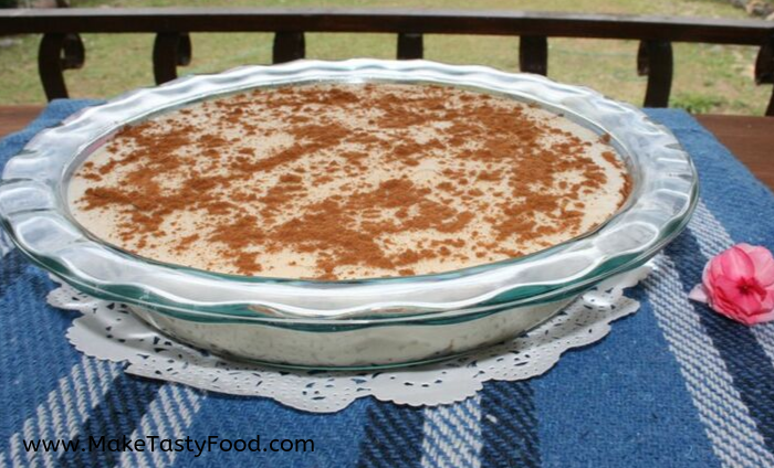 a pie dish with milk tart sprinkled with cinnamon