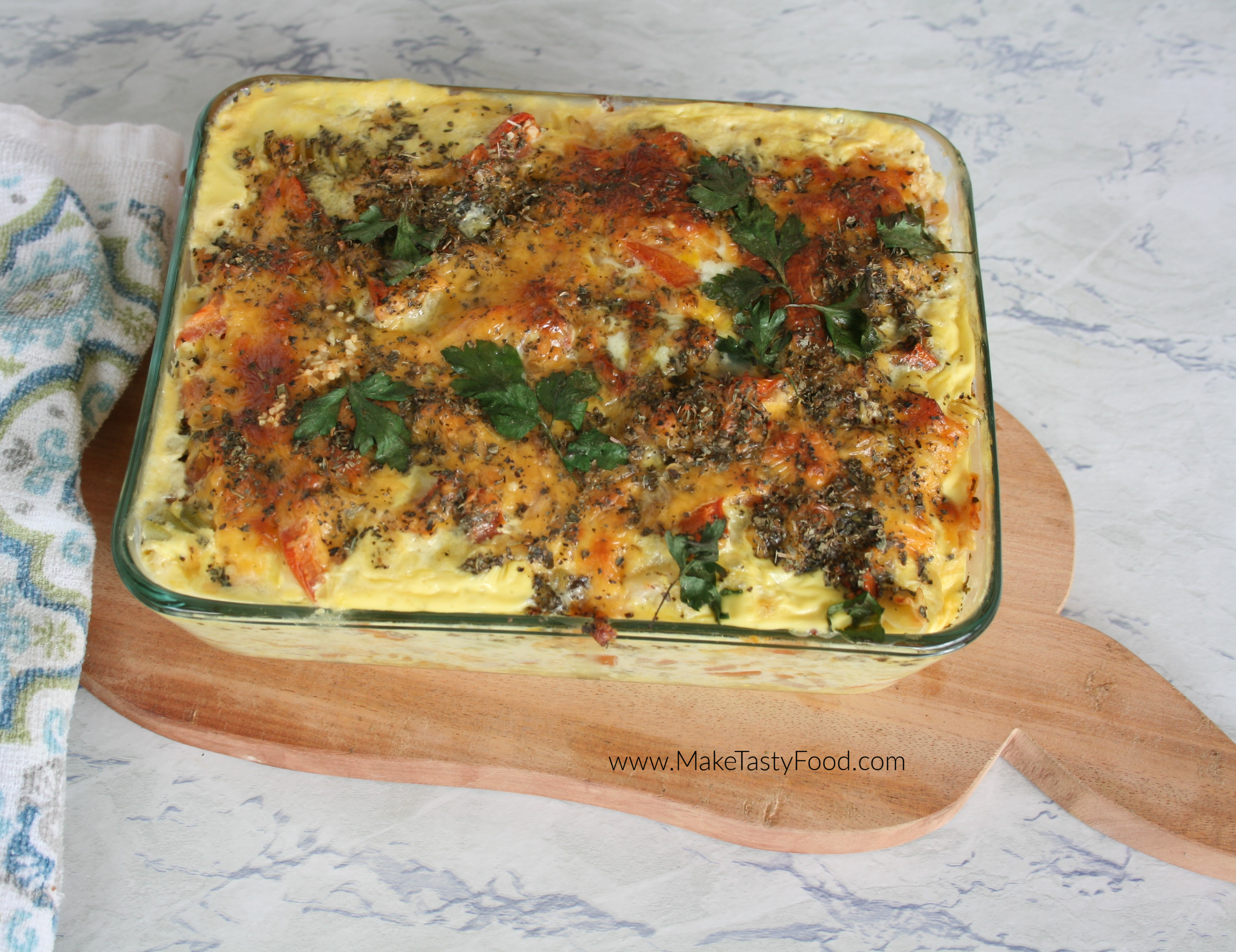 top view of the golden brown baked macaroni and cheese with parsley