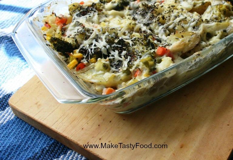 tasty creamy mixed vegetable dish and potato baked