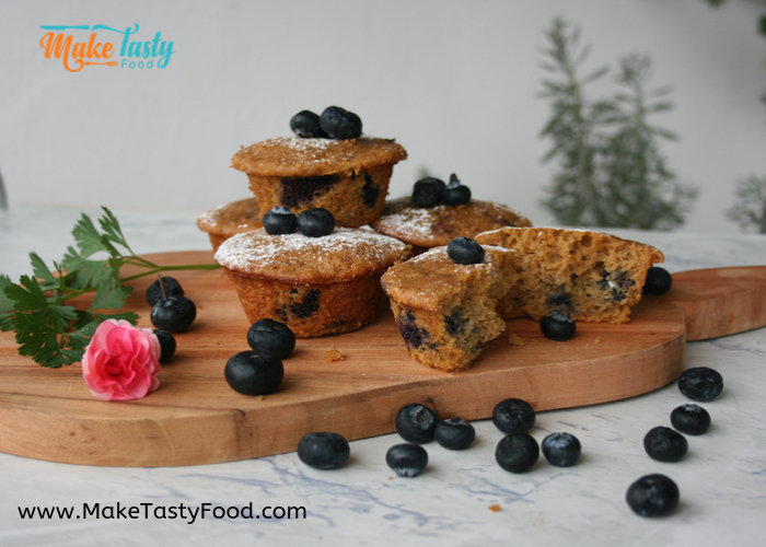 Banana blueberry muffins on a bread board
