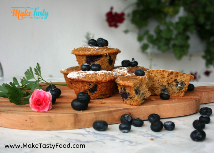 blueberry and banana muffins cut on a board