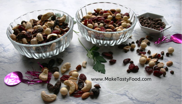 two easy snacks made with peanuts raisons cashews and some white chocolate and dark chocolate