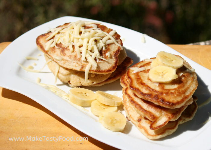 plated flapjacks with banana and cheese and honey.