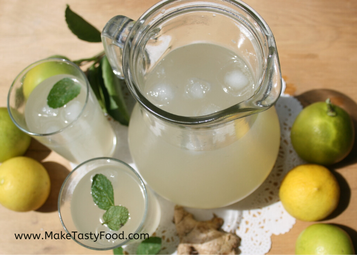 Jug of ginger beer and glasses with ice and mint