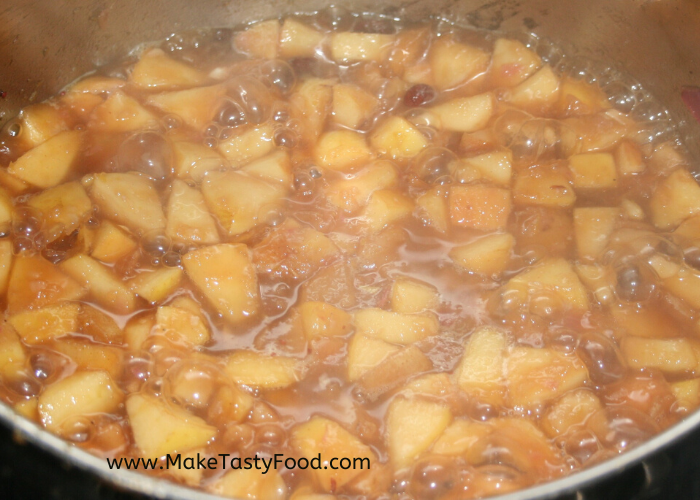 cut up pears cooking in sauce in a pot