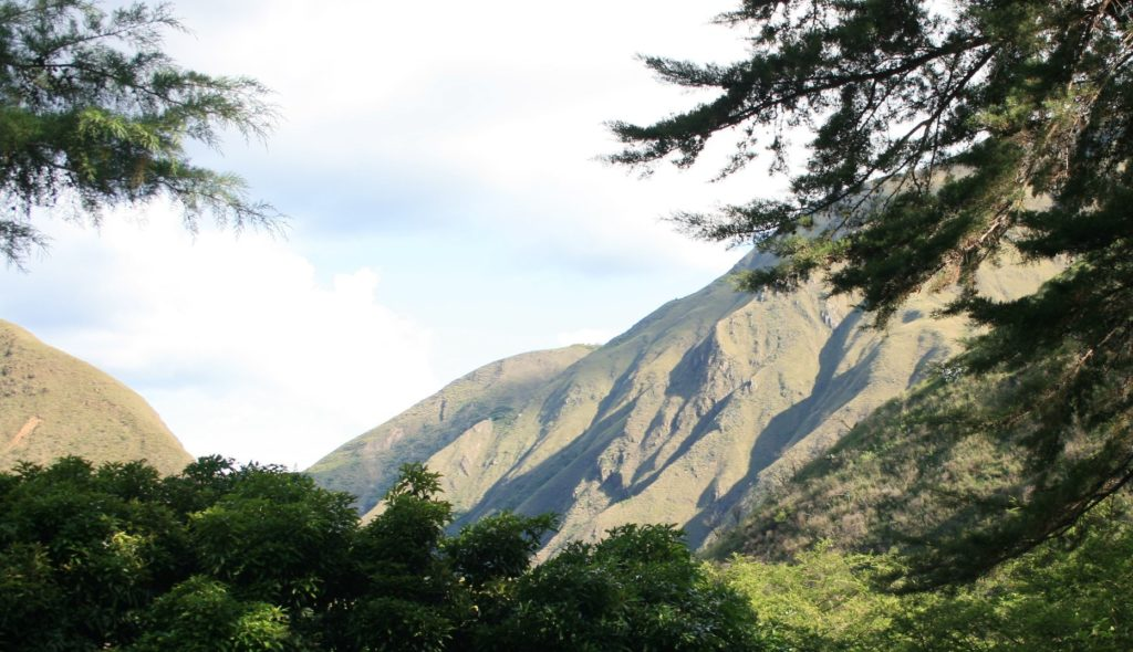 a view from the house of the mountains in chirusco valley vilcabamba Loja Ecuador
