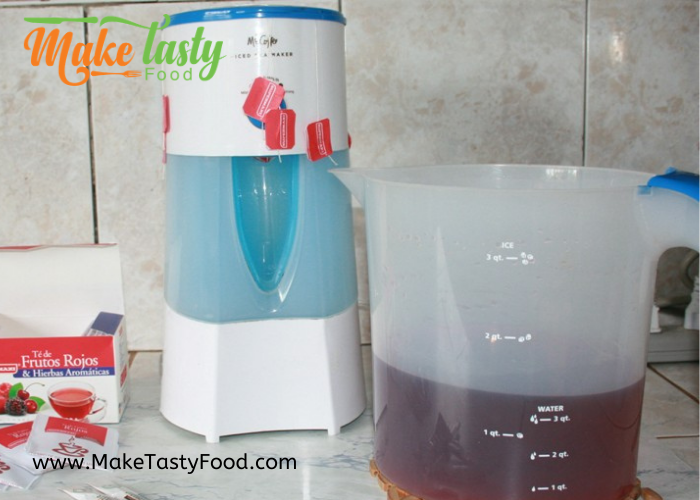 iced tea maker with fruity tea being made