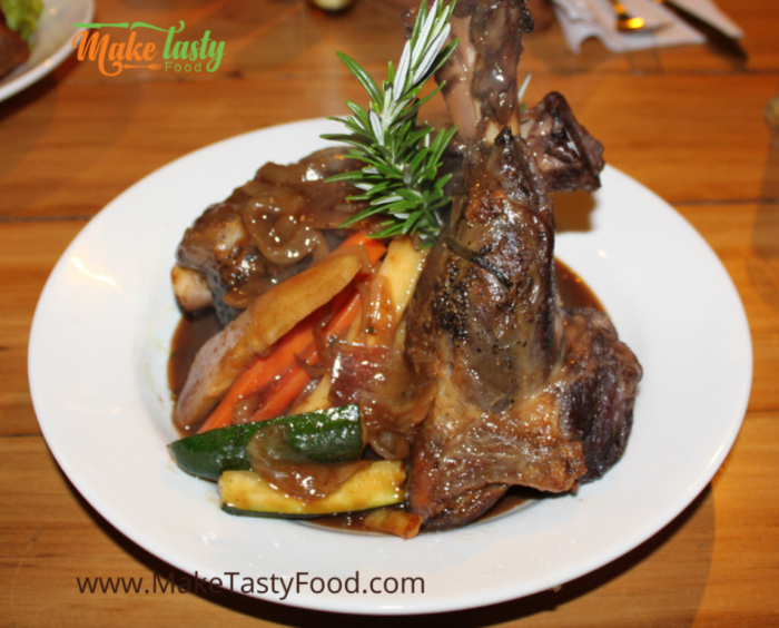 a lamb shank  potjie plated and ready to eat
