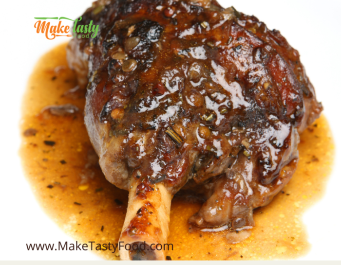 a well done lamb shank with spices and gravy