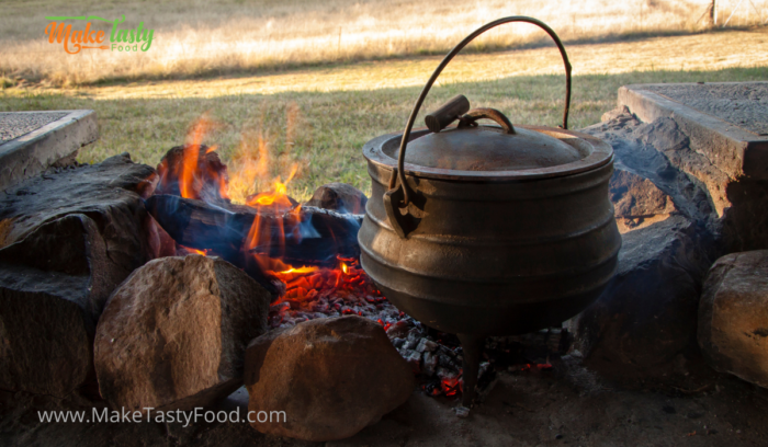 A fire and a potjie on the coals for lamb shank and vegetables