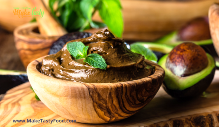 avocado mousse in a wooden bowl