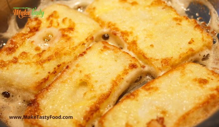 frying the french toast in a pan with butter