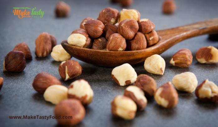 hazel nuts  shown on a spoon