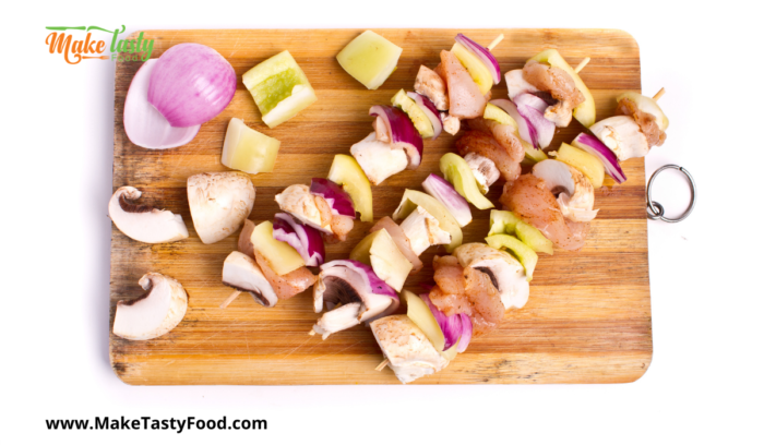 making the chicken and veg kebobs on skewers