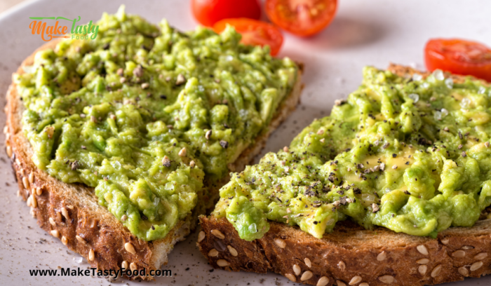 whole wheat toast with mashed spiced avocado on top for a healthy breakfast
