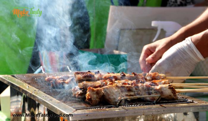 grilling or braaiing the beef sosaties on a braai.