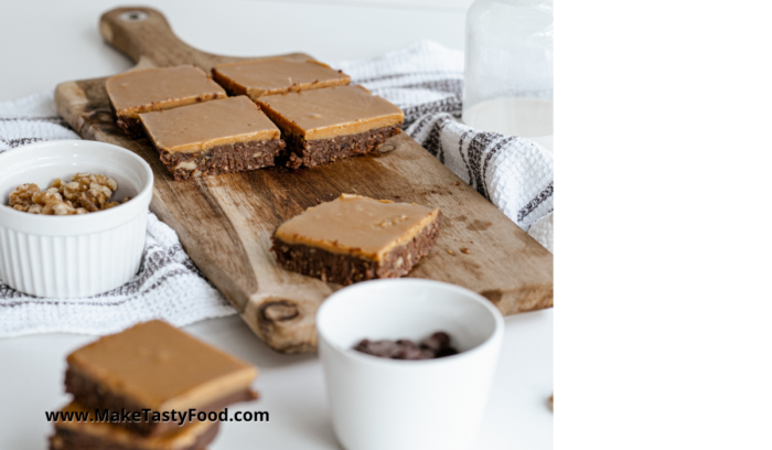 chocolate peanut brownies sliced on a bread board