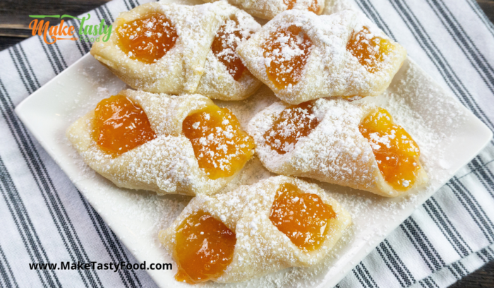a plated sugar dusted jam cookies