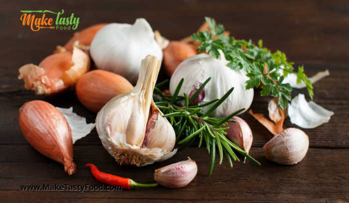 garlic and onions and rosemary herbs for adding to the roasted chicken and potato's