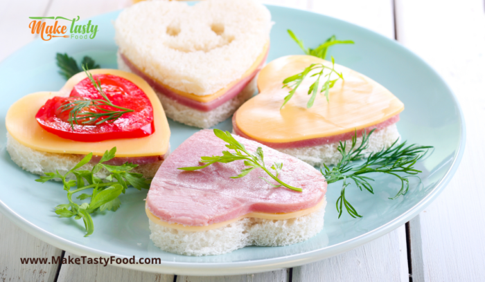 a plate of easy heart sandwiches for fathers day