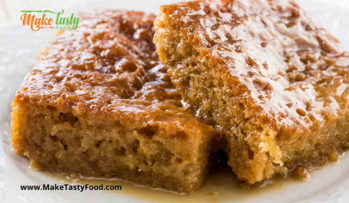 two slices of saucy malva pudding served