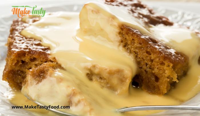 A serving of malva pudding with custard poured over to enjoy