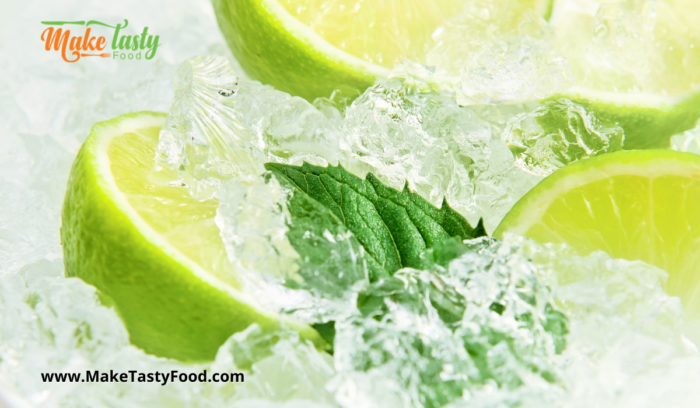 limes with sprig of mint in ice for lime juice drink
